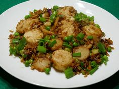 Quick Fix: Tasty scallops dish requires very little cooking   News Break Quick Fried Rice, Seafood Scallops, Scallop Dishes, Hoisin Sauce, Frozen Peas, Rice Recipes, Dinner Plates, Entrees
