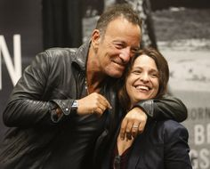 Bruce Springsteen embraces Stephanie Casella as he appeared for pictures with his fans at the Barnes and Noble in Freehold  9/25/16 (Ed Murray | NJ Advance Media for NJ.com)