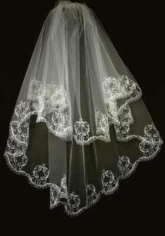 Beautiful wedding veil with embroidered edging. Made with fine quality Italian tulle (100% nylon). Comes with a hair comb. 2 layers: approx. 80