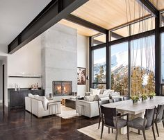 Concrete floors colored to compliment the wood Modern mountain home boasts chic and stylish living in Montana