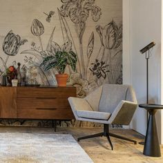 Style tip from Creative Director 'Keep your basic furniture pieces simple and style your interior to perfection with a dramatic wall paper. This Tulips wall paper from is one of our favourites'. Creative Director, Accent Chairs, Flooring, Dining, Retro, Wallpaper, Simple, Interior, Tulips