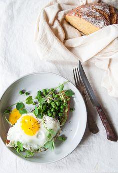 no-knead butternut squash bread with avocado, sautéed peas, fried egg and pea shoots.
