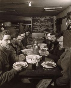 Antarctica (June 21, 1934). Dinner members of the expedition of Admiral Richard E. Birdsa.