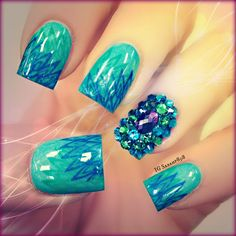 Peacock Nails - very original take on this. Love the feather interpretation and the gem covered accent nail is beautiful (but maybe not practical). Love this!
