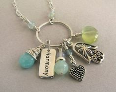 Harmony and protection sterling silver charm necklace with amazonite, green prehnite, aquamarines, peruvian opal and chalcedony.