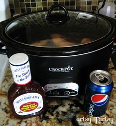 3 Ingredient Slow Cooker BBQ Chicken at artsyfartsymama.com  I've made this several times (using either coke zero or just all BBQ sauce) and it could not be easier or yummier!