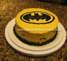 Homemade Batman Birthday Cake: My son wanted a Batman theme.  I thought this was easy enough.  I just used a box cake mix to make 2 cake rounds and stacked.  I used concentrate yellow