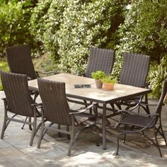 """$800 @home depot. non-stacking chairs, 70"""" ceramic table. No cushions. Assembly can be tricky. Hampton Bay Pembrey 7-Piece Patio Dining Set"""