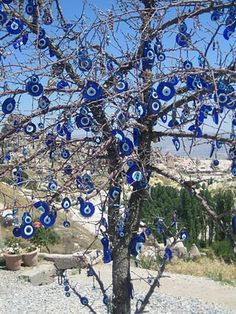 I'm thinking that I can hang some of these from the tree in my front yard (this evil eye tree is located in Cappadocia, Turkey.)