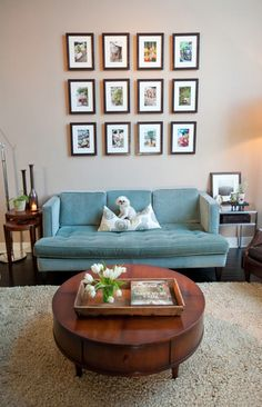 """Love the blue sofa, and the owners """"warmed it up"""" with the brown wooden tables - Good idea!"""
