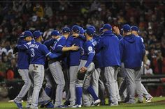 The Toronto Blue Jays celebrate their victory over the Boston Red Sox at Fenway Park.