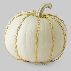 This white pumpkin with brass chains is as chic as it is ghostly. First, spray paint your pumpkin, then drape brass chain down the side of the pumpkin and nail the bottom end in place.