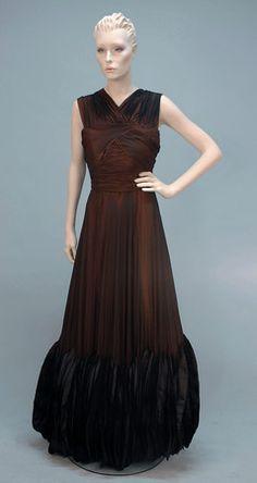JEAN DESSES COUTURE SILK PETAL GOWN, 1950's. Sleeveless black chiffon over pumpkin silk