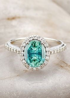 Unique Sapphire Engagement Ring. This is just stunning and my favourite colour.