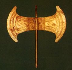 Made of bronze and gold, second milleniuim BC  found ini the Arkalochori Cave, called the Arkalochori Axe