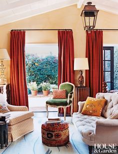 A tufted sofa and patterned ottoman accent designer Peter Dunham's Los Angeles home.