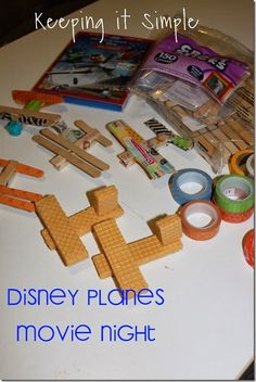 Keeping it Simple: Family Movie Night with Disney Planes.  Make planes out of Popsicle sticks and wafer cookies. #OwnDisneyPlanes