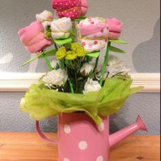 Onsie, socks, and burn cloths flower arrangement