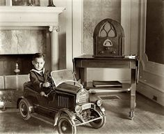In 1931, all boys under the age of 8 had to wear sailor suits and pose in miniature automobiles for the amusement of town elders. It was the law...