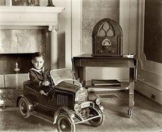 "Washington, D.C., circa 1931. ""Child seated in toy automobile"