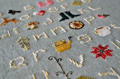 Winterwoods ABCs Cross Stitch Sampler  My three favorite pieces: the teapot, tea cup, and star (quilt block to me). :)