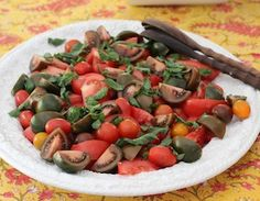 Victoria Amory's Tomato Salad dressed with olive oil and mint. Yes, just olive oil and mint. Delicious!  www.victoriaamory.com