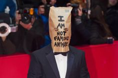 Shia LaBeouf wears a paper bag on his head to the premiere of Nymphomaniac at Berlin Film Festival following Eric Cantona plagiarism