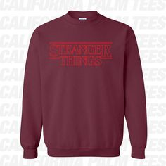 Stranger Things Logo Sweatshirt. Style: Crewneck Sweatshirt. Sizes: Small - 3XL. Colors : Sports grey, ash Grey, Graphite, Royal, Heliconia/ Hot Pink, Green, Sand, Red, Sapphire. Brand : Gildan. Made to order. Ships from southern California 2 - 3 business days via First class or upgrade to priority mail.  Gildan - Heavy Blend Crewneck Sweatshirt - 18000 Specs:  8.0 oz., pre-shrunk 50/50 cotton/polyester Reduced pilling and softer air-jet spun yarn 1x1 athletic rib knit collar, ...