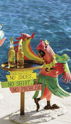 A colorful character, complete with grass skirt, lei, coconut bra and a margarita, Polly the Parrot is the quintessential party animal. | Margaritaville by Frontgate