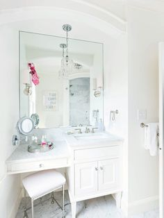 small vanity with sink and makeup area with white granite top, white cabinet under, large mirror, round retractable makeup mirror, crystal pendant of Makeup Area in Vanity to Treat a Lady Right Bathroom With Makeup Vanity, Small Bathroom Vanities, White Bathroom, Modern Bathroom, Bathroom Cabinets, Master Bathroom, Bathroom Ideas, Bathroom Designs, Vanity With Sink