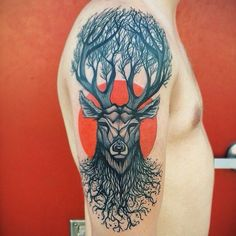 Awesome deer tree tattoo by Dino Nemec!
