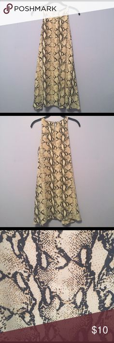 Ark & Co. Snake Skin Dreams Ark & Co. Snake Skin Dress - SMALL - Only worn once! Inside slip is ripped slightly on each side (as shown in the last three photos) but is not noticeable when wearing the dress. 100% Polyester. Ark & Co Dresses Midi