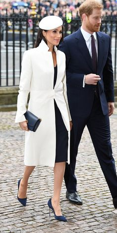 Meghan Markle, 36, today looked chic in navy and white as she stepped out in Amanda Wakele... #meghanmarkle #princeharry