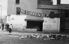 Various political slogans adorn a partially destroyed building, Shankill Road. c. 1970