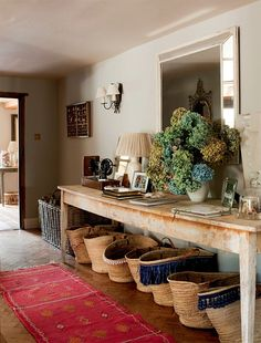 Large entryway and you can never have enough baskets with a house full of kids.