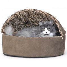 A warm, snuggly place to snooze.Pure heaven is the only way to describe this heated cat   bed