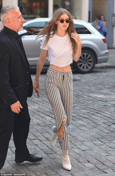 Letting loose: Gigi Hadid stepped out without a bra on when she took to the streets of New...