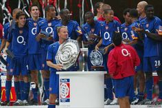 Dennis Bergkamp collects the 2004 Community Shield wearing the classic blue away jersey of the Arsenal Football Club Arsenal Players, Arsenal Fc, Arsenal Football, Cardiff Millenium Stadium, Fa Community Shield, Dennis Bergkamp, Flying Dutchman, Kids Soccer, Sports Photos