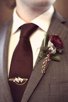 Pantone Marsala tie and boutonniere.