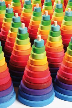 Wooden stacking toy. Rainbow Toy. Grimm's Toys Conical Tower