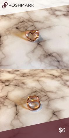 Charming Charlie Rose Gold Heart Ring Charming Charlie Rose Gold Heart Ring. Believed to be size 7 (but not positive what size it is) Worn once or twice. Charming Charlie Jewelry Rings