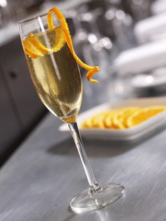 This is one of my all-time favorite drinks! :) The Champagne Classic French 75 Cocktail - Rob Palmer / Photolibrary / Getty Images