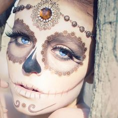 Going for a more glamorous way to achieve the sugar skull? Flickr user Laura Evans pulls this look off perfectly by using neutral colors to make the jewel headband the focus.