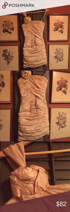 BCBG cocktail dress This gold cocktail dress is stunning and very comfortable! It is one shoulder. It was worn once to a homecoming dance and is in nearly perfect condition BCBG Dresses One Shoulder