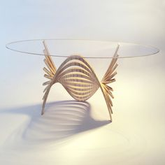 Marc Wood from Nottingham Trent's Furniture and Product Design course designed the 'Curves Console'. It is inspired by parabolic curves and produced using a combination of steam bending techniques and algorithmic computer modeling processes.