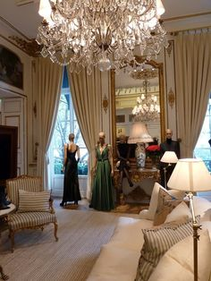 PARIS Ralph Lauren flagship store with crystal chandeliers, silky curtains and gold-leaf mouldings....