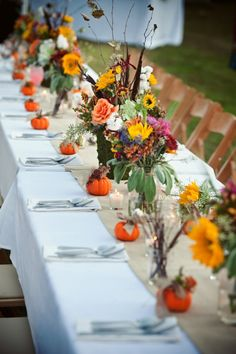 Too cute... love this! An autumnal wedding table decorated with pretty flowers and teeny tiny pumpkins. Perfect for October.