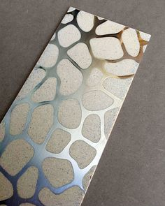 Engineered Polymer Concrete Tile with Embedded Metal Decoration by Decotal. - They can be used in bathrooms or outdoors, as they are completely impermeable and weather resistant. Use them to create carpet like surfaces, as frames to a more neutral pattern or go for fully-patterned surfaces for a decadent, luxurious result.