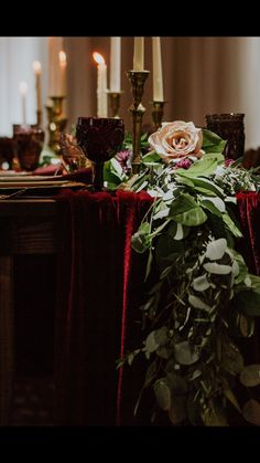 Rich burgundy velvet table setting for a rustic and elegant wedding. Created for a styled wedding at the Safety Harbor Resort.