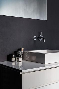 Dark walls and a statement bathroom